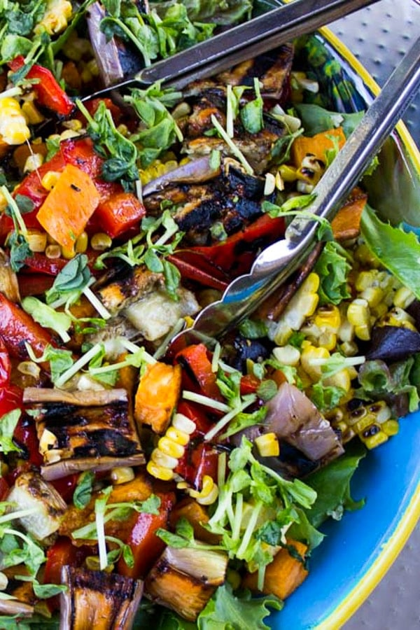 Party Salad with Grilled Vegetables and Quinoa in large serving bowl in backyard p