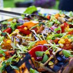 Party Salad with Grilled Vegetables and Quinoa in large serving bowl in backyard p1