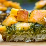 pesto ricotta crostini appetizer on cutting board p1