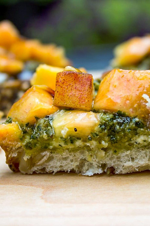 pesto ricotta crostini appetizer on cutting board p1