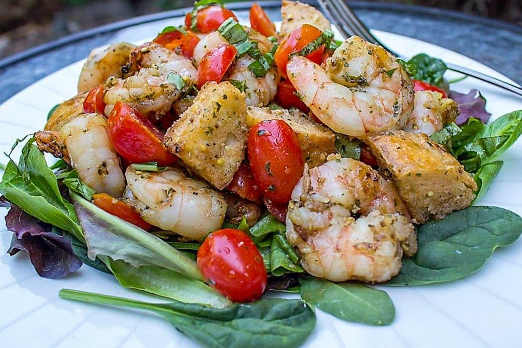 Grilled Pesto Shrimp Panzanella on a plate 1