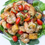 Grilled Pesto Shrimp Panzanella on a plate