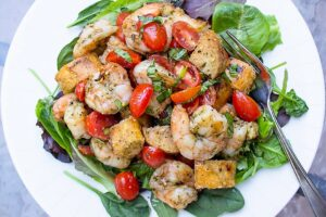 Grilled Pesto Shrimp Panzanella on a plate