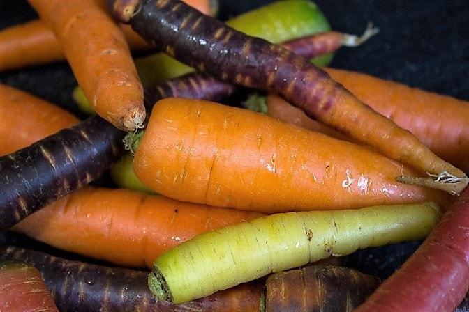 pile of multi coloured carrots