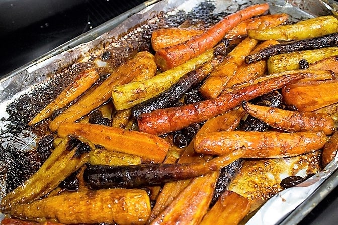 Roasted Glazed Carrot Tzimmes on pan