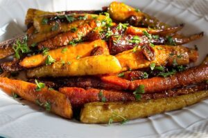 Roasted Glazed Carrot Tzimmes in serving dish