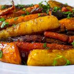 Roasted Glazed Carrot Tzimmes on serving plate p2
