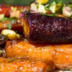 close up of Roasted Glazed Carrot Tzimmes on serving plate p