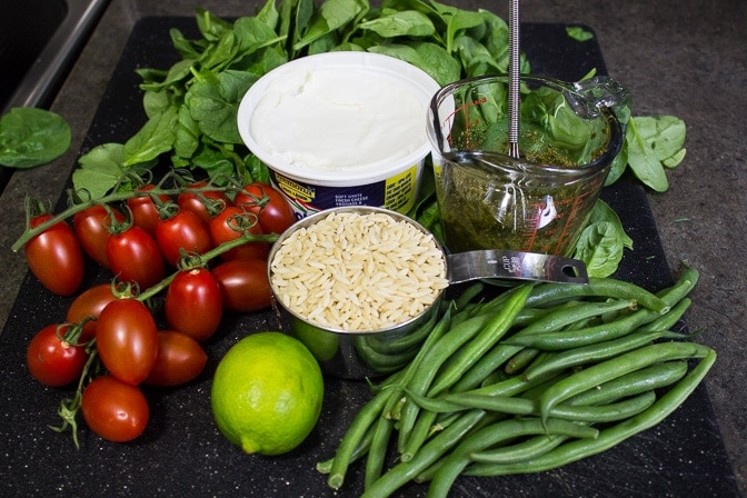 pesto,orzo tomatoes, beans, spinach, goat cheese, lime