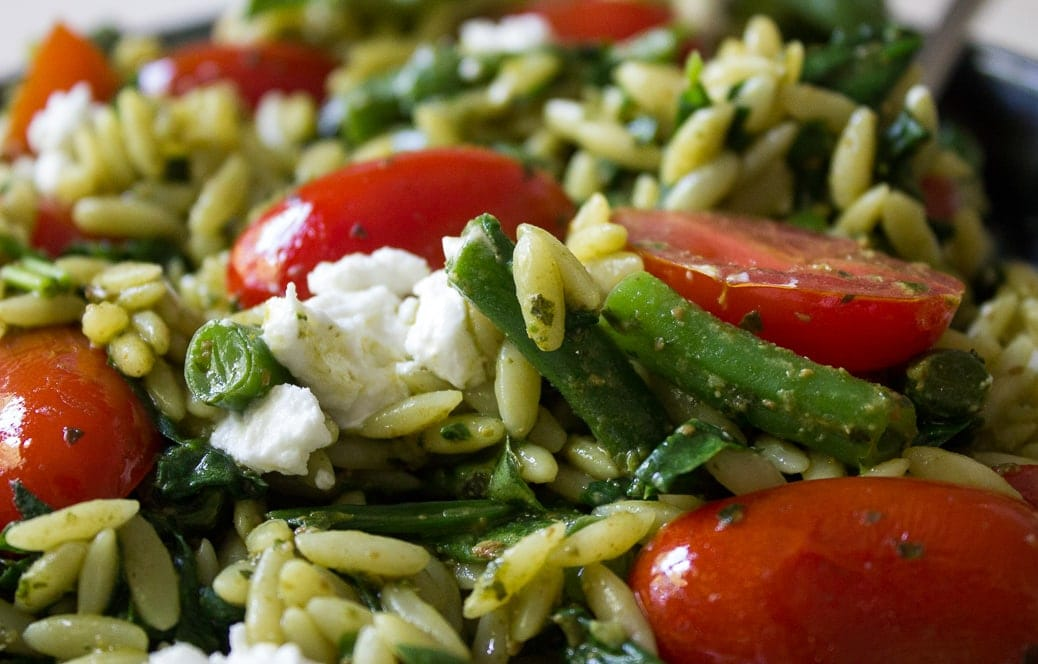 pesto and vegetable orzo in a bowl 2
