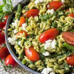 pesto and vegetable orzo. Green beans, spinach, tomatoes and goat cheese make this a super healthy and tasty side dish.