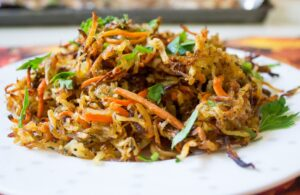 Roasted Shredded Potato Crisps with onions, carrots and smoked paprika. Delish!