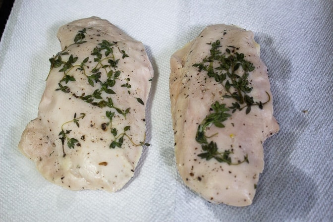 2 chicken breasts after sous vide cooking on paper towel