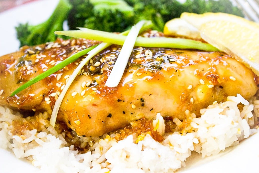 sous Vide Chicken with citrus glaze garnished with sesame seeds and scallions over white rice