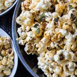 Spiced Herb Popcorn in 3 bowls on placemat