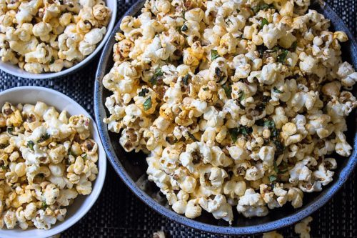 Spiced herb popcorn with smoked paprika, lemon zest, garlic and fresh herbs. Addictive!