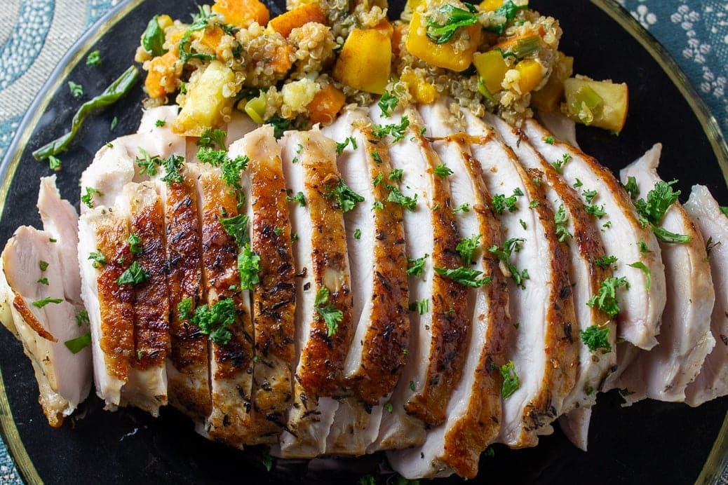 sous vide turkey breast on plate with stuffing
