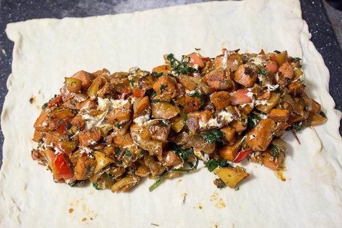 vegetable mixture on top of dough ready to be folded