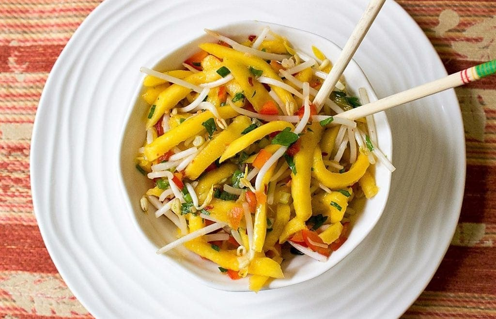 fresh mango salad with crunch bean sprouts. Sweet, tangy and spicy.