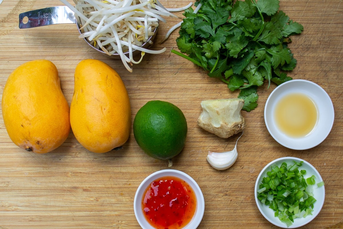 mangos, lime, sweet chili sauce, cilantro, green onion, lime, bean sprouts, garlic, ginger
