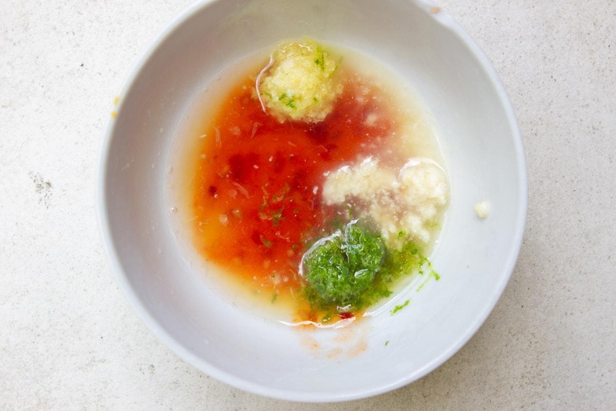 mango salad dressing ingredients in bowl