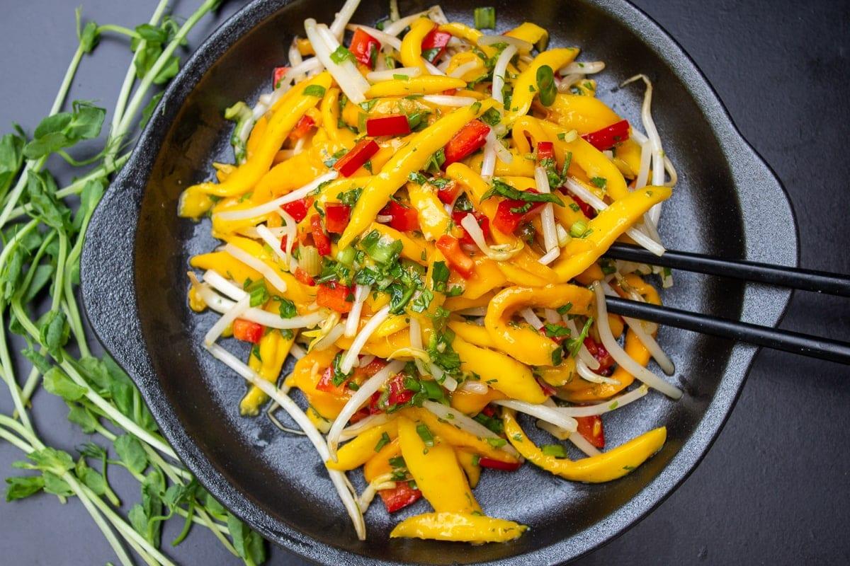 Thai mango salad in bowl 1