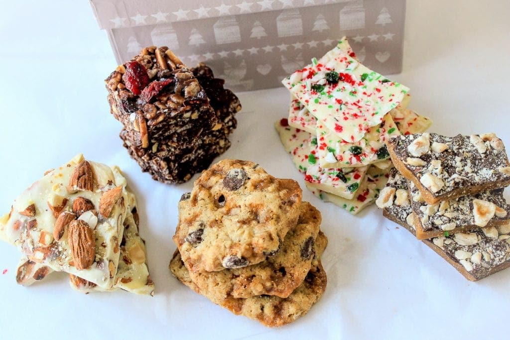 various cookies and bars in a box with tissue paper f