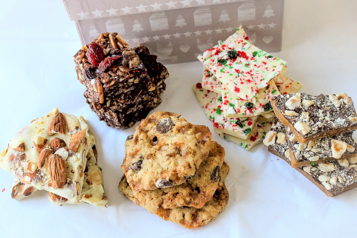 various cookies and bars in a box with tissue paper