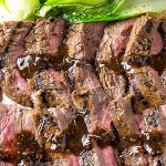 sous vide flank steak sliced on cutting board with bok choy p2