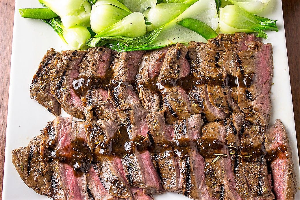 sous vide flank steak sliced on cutting board with bok choy 2