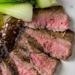 Sous Vide Flank Steak on plate with balsamic sauce and bok choy