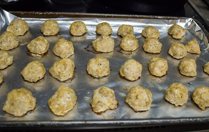 Chicken Meatballs baked on one side so far on pan