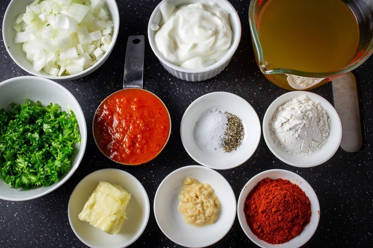 chopped onions, sour cream, chicken broth, flour, salt pepper, tomato sauce, parsley, butter, garlic, paprika