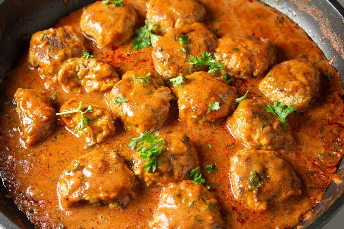 chicken meatballs in paprikash sauce in pan