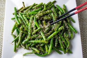 Chinese Stir-Fry Green Beans on plate with sesame seed garnish