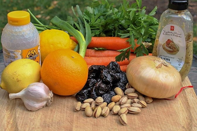 ingredients for company chicken with citrus, carrots, prunes and pistachios