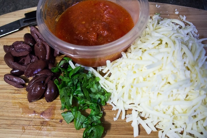 basil, grated cheese, olives, tomato sauce