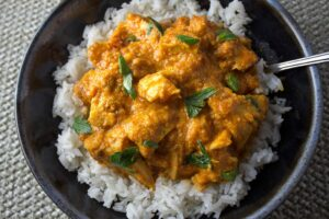Indian Butter Chicken (Sous Vide or Regular). Chicken bathed in a creamy tomato onion sauce with rich Indian spices.
