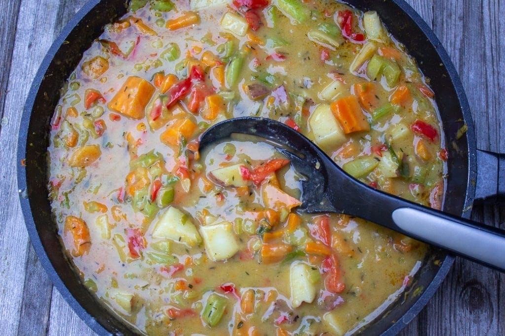 sauted veggies cooking in sauce in skillet
