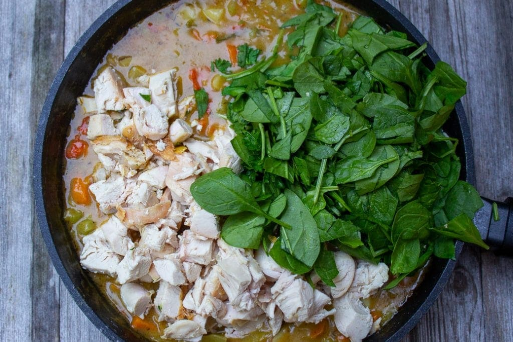 chicken chunks and spinach added to filling in skillet