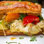 chicken pot pie filling sandwiched between 2 layers puff pastry crust p