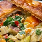 Skillet Chicken Pot Pie plate topped with puff pastry crust p2