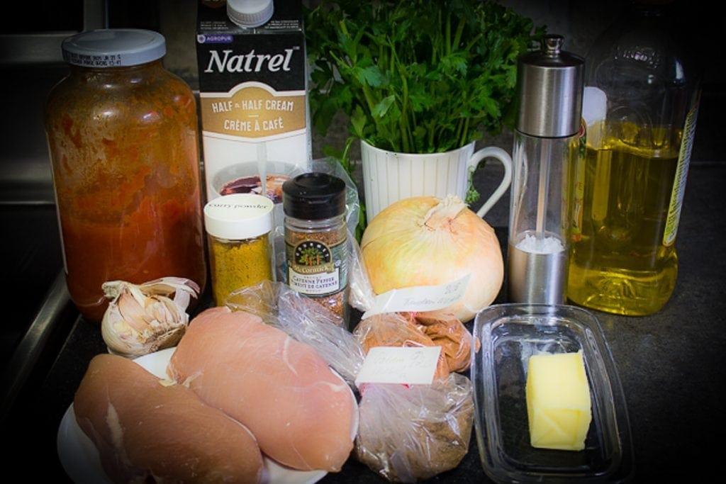 chicken breasts, broth, curry powder, Garam masala, Tandoori masala, garlic onion, tomato sauce butter, cream parsley