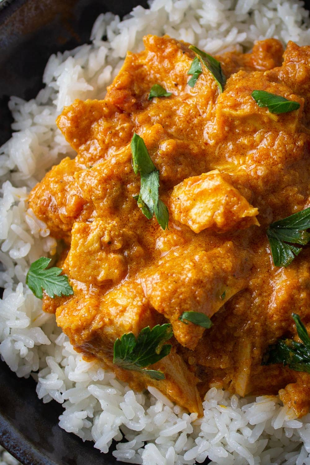butter chicken over rice in bowl p1