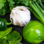 Thai Green Curry Paste ingredients of garlic lime, cilantro, kaffir leaves, jalapeno, green onion