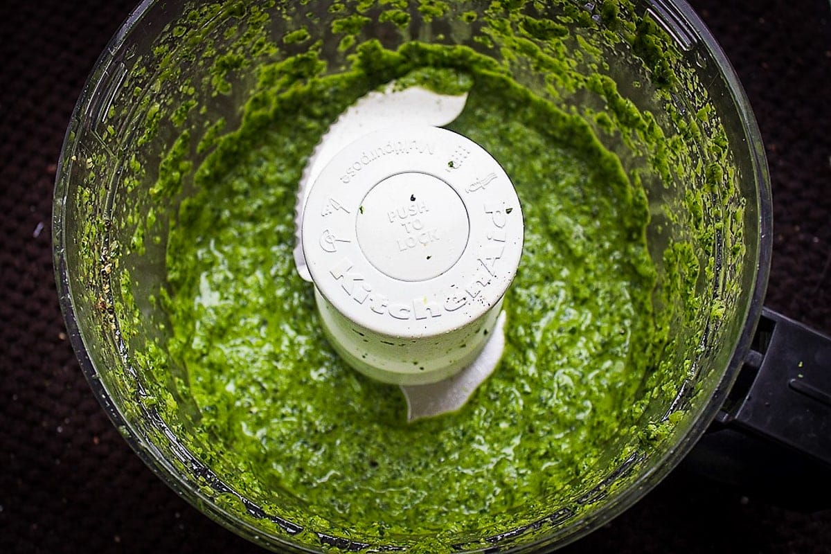 pureed green curry paste in food processor bowl