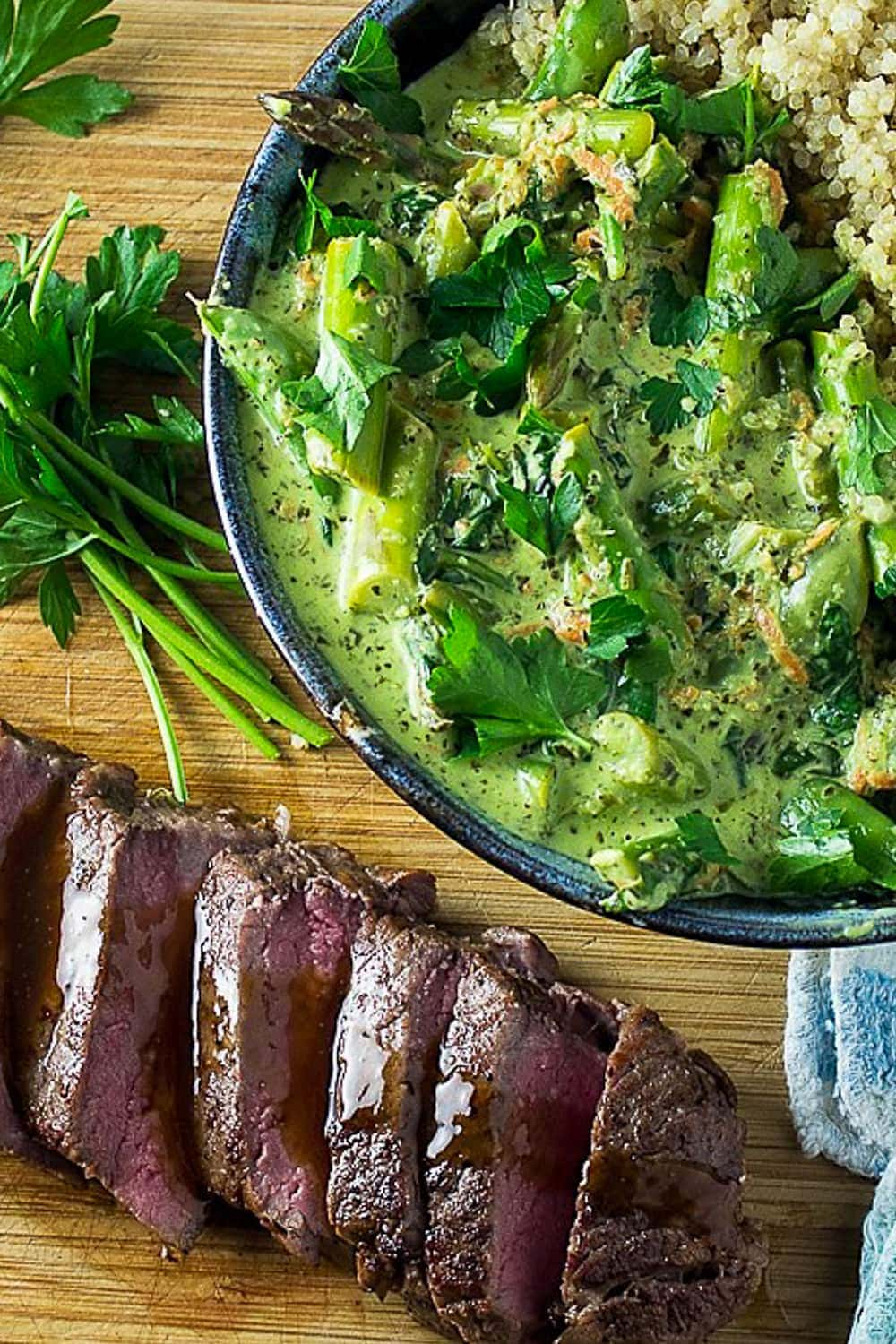 bowl of vegetable green curry with steak on cutting board
