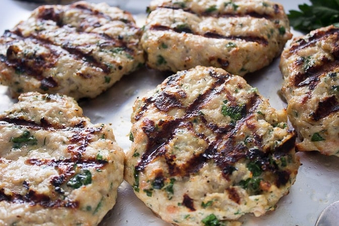grilled chicken burgers reading for assembling in buns