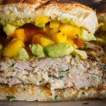 cut open Grilled Chicken Burgers in bun with mango avocado salsa p1