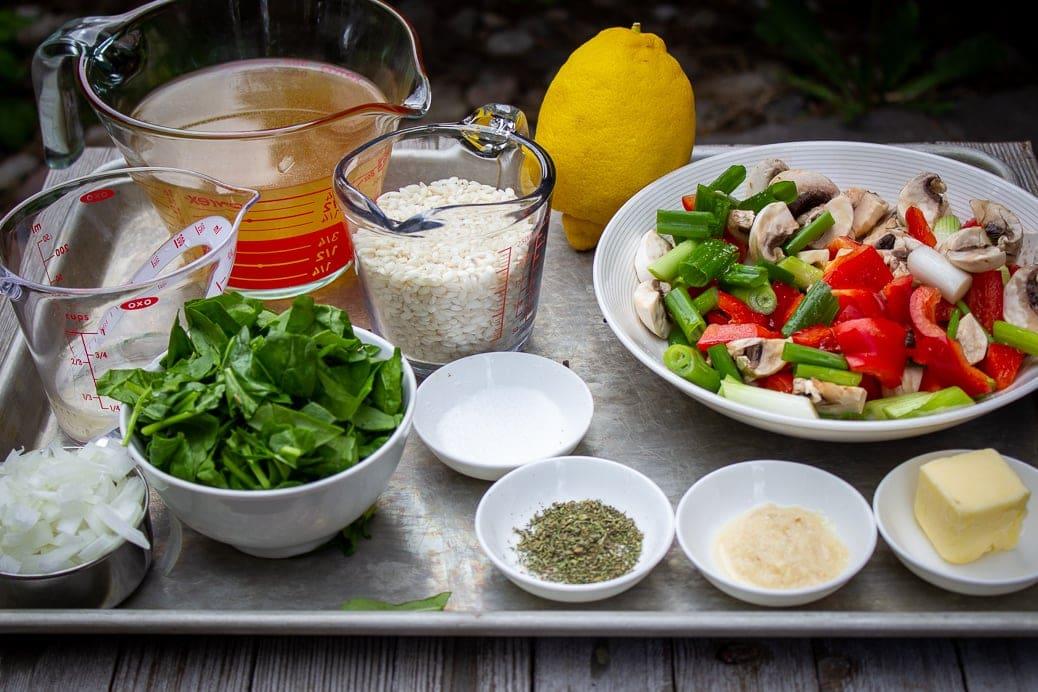 spinach, broth, wine, seasonings, rice, lemon, chopped vegetables